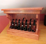 Haunted bookshop tobacco pipe rack