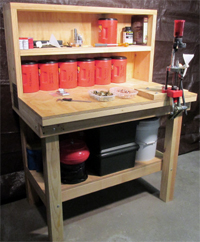 Picture of an ammunition reloading bench, with  interchangeable bullet press, made from plans.